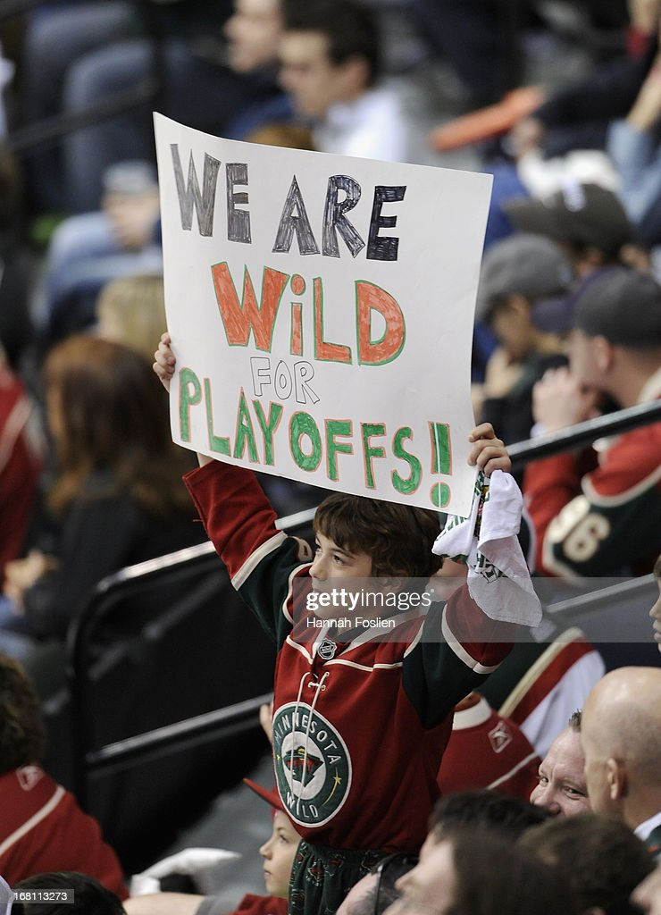 A fan holds up a sign during the first period between the Minnesota Wild and the Chicago Blackhawks of Game Three of the Western Conference Quarterfinals during the 2013 NHL Stanley Cup Playoffs at Xcel Energy Center on May 5, 2013 in St Paul, Minnesota.