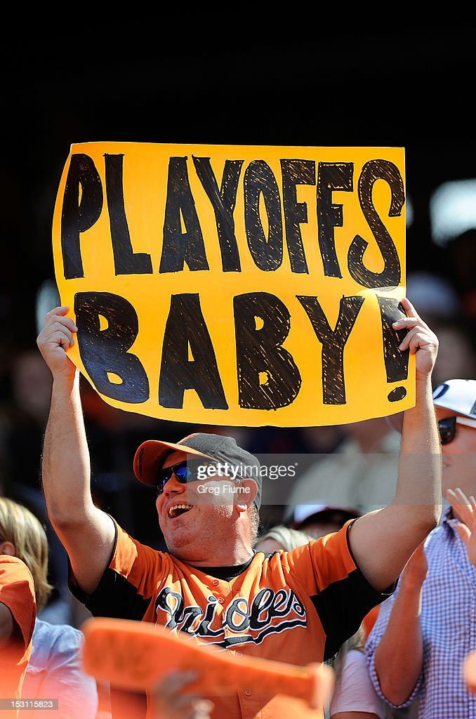 A fan holds up a sign during the game between the Baltimore Orioles and the Boston Red Sox at Oriole Park at Camden Yards on September 30, 2012 in Baltimore, Maryland.