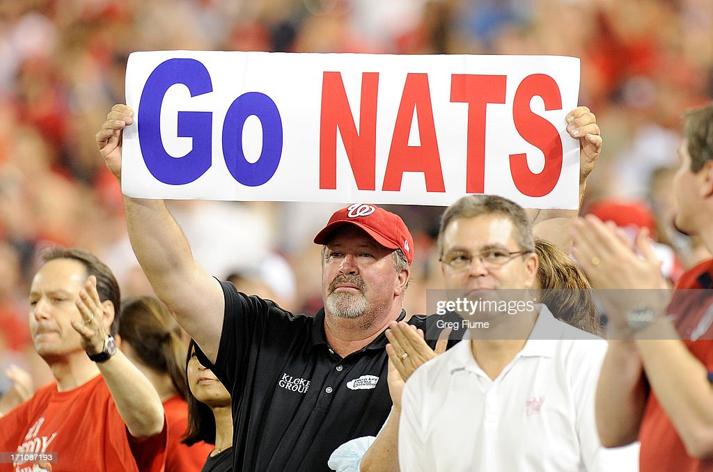 A fan holds up a sign during the game between the Colorado Rockies and the Washington Nationals at Nationals Park on June 21, 2013 in Washington, DC.