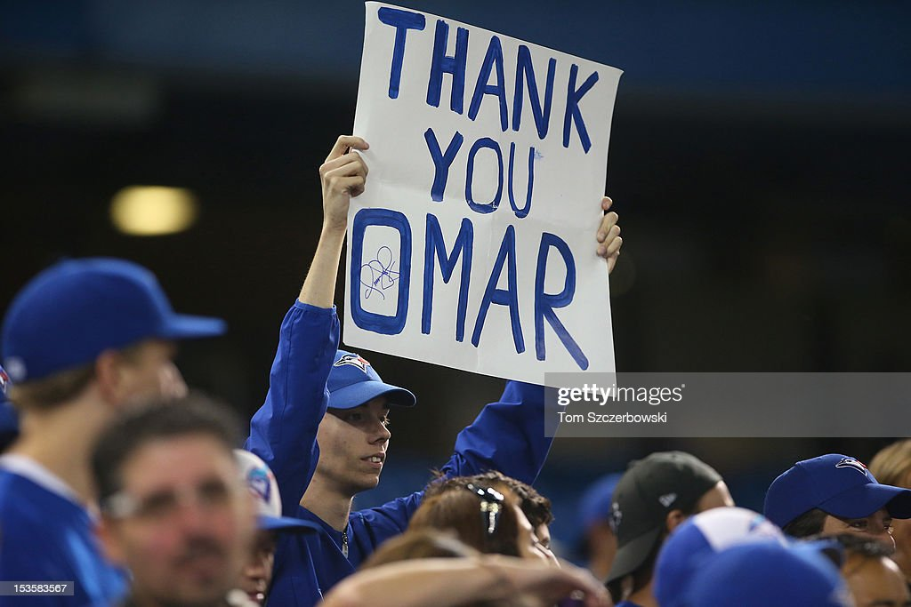 A fan holds up a sign for Omar Vizquel #13 of the Toronto Blue Jays on the final game of his career during MLB game action against the Minnesota Twins on October 3, 2012 at Rogers Centre in Toronto, Ontario, Canada.