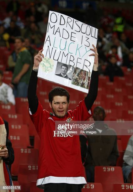 A fan holds up a sign saying 'O'Driscoll made 13 a lucky number'
