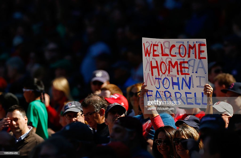 A fan holds up a sign that reads 'Welcome Home John Farrell' during the Opening Day game between the Boston Red Sox and the Baltimore Orioles on April 8, 2013 at Fenway Park in Boston, Massachusetts.
