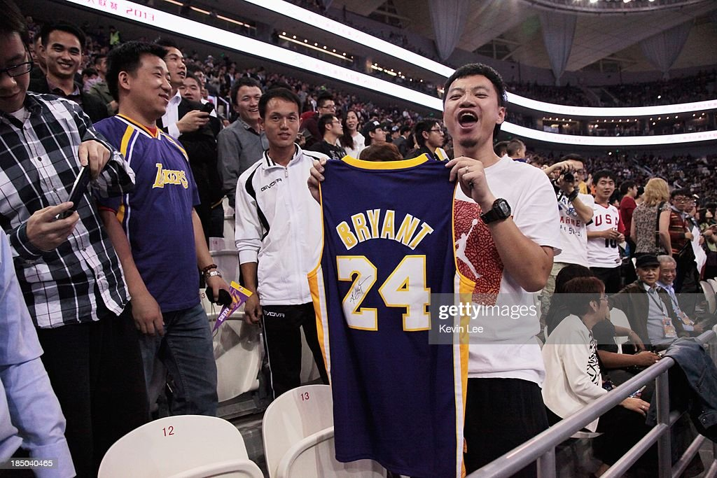 A fan holds up a signed T-shirt from Kobe Bryant of the Los Angeles Lakers at NBA Fans Appreciation day on October 17, 2013 in Shanghai, China.