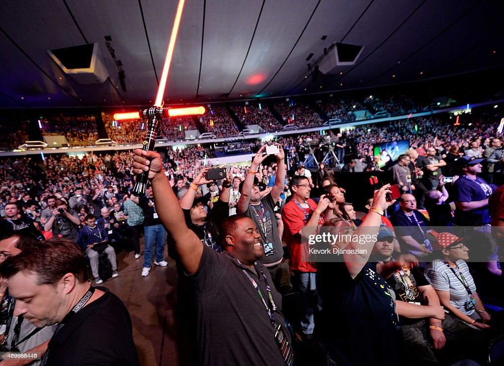 A fan holds up a 'Star Wars' lightsaber at the kickoff event of Disney's Star Wars Celebration 2015 at the Anaheim Convention Center April 16 2015...