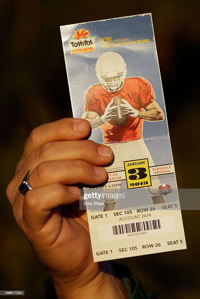 A fan holds up a ticket for the Tostitos Fiesta Bowl between the Oregon Ducks and the Kansas State Wildcats at University of Phoenix Stadium on January 3, 2013 in Glendale, Arizona.
