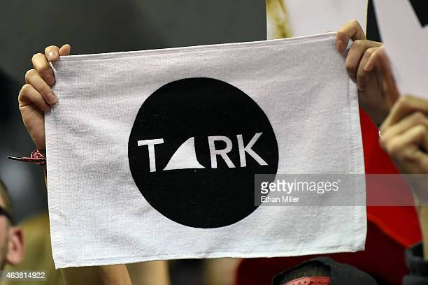 A fan holds up a towel in memory of former UNLV head basketball coach Jerry Tarkanian before UNLV's game against the Boise State Broncos at the...