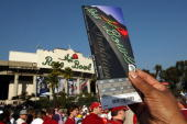 A fan holds up his ticket for the Citi BCS National Championship game between the Texas Longhorns and the Alabama Crimson Tide at the Rose Bowl on...