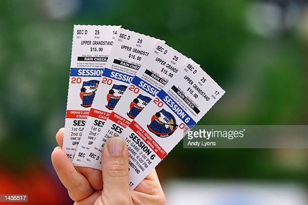 A fan holds up tickets to the game between the Cal State Fullerton Titans and the Tulane Green Wave during the College World Series on June 12 2001...
