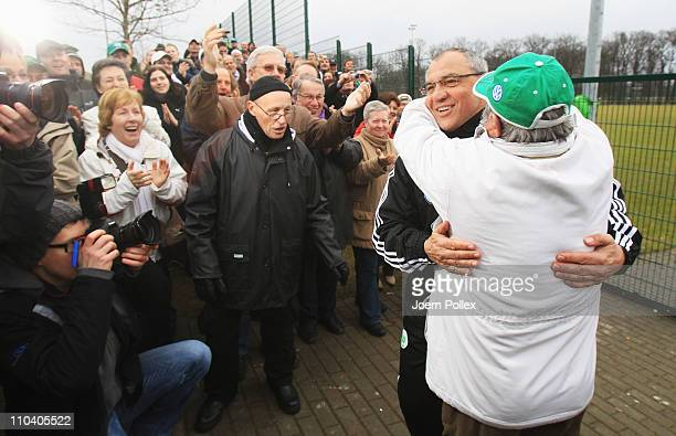 A fan hugs head coach Felix Magath after the training session of VfL Wolfsburg on March 18 2011 in Wolfsburg Germany