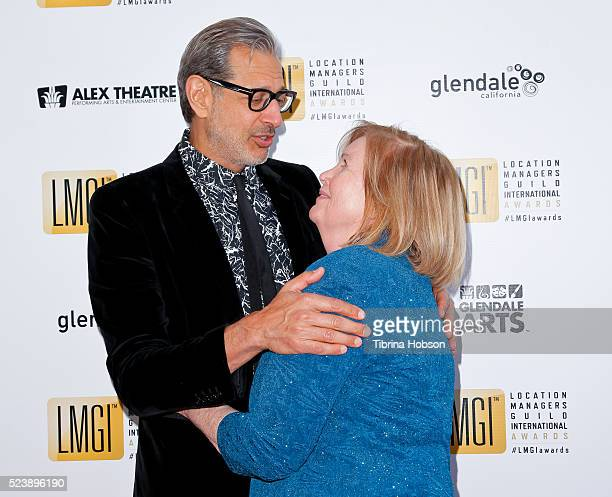 A fan hugs Jeff Goldblum at the 3rd annual Location Managers Guild International Awards at The Alex Theatre on April 23 2016 in Glendale California