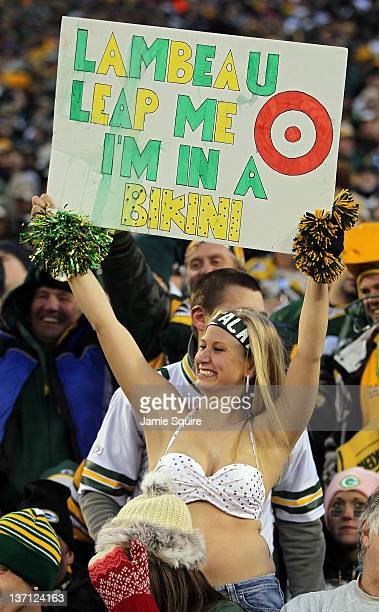 A fan in a bikini holds up a sign during their NFC Divisional playoff game between the Green Bay Packers and the New York Giants at Lambeau Field on...