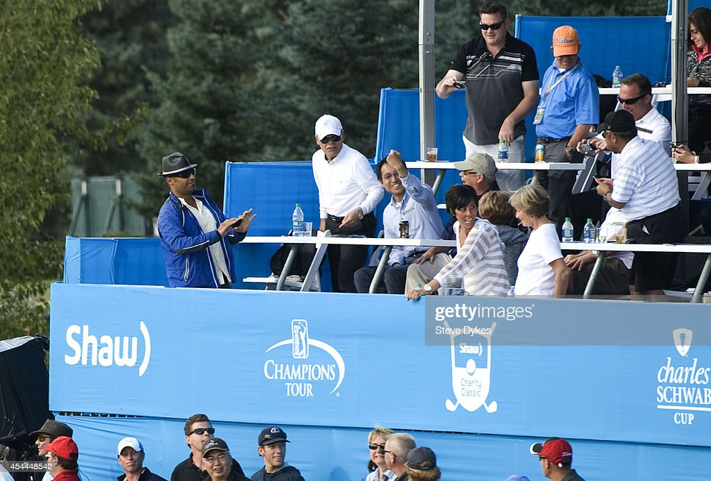 A fan in a corporate box on on the 18th green holds an errant ball from Billy Andrade during a playoff with Fred Couples after the final round of the Shaw Charity Classic at the Canyon Meadows Golf & Country Club on August 31, 2014 in Calgary, Canada.