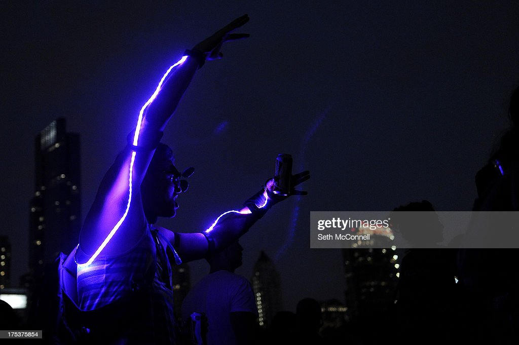 A fan in a home made LED suit dances as Nine Inch Nails perform during Lollapalooza at Grant Park on August 2, 2013 in Chicago, Illinois.