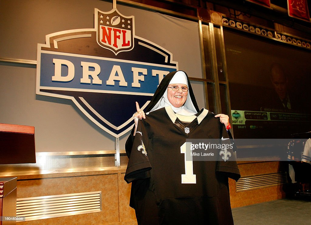A fan in a nun's habit holds up a New Orleans Saints jersey at the NFL Draft display during the Super Bowl XLVII NFL Experience at the Ernest N. Morial Convention Center on January 31, 2013 in New Orleans, Louisiana.