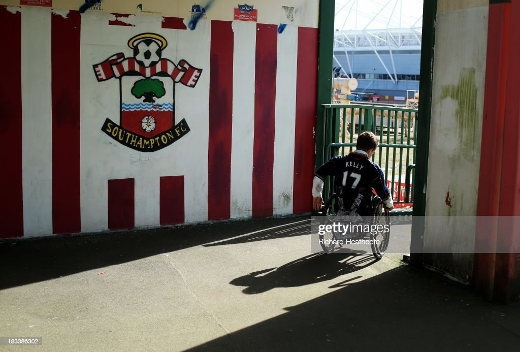 A fan in a wheelchair makes his way to the ground prior to the Barclays Premier League match between Southampton and Swansea City at St Mary's Stadium on October 6, 2013 in Southampton, England.