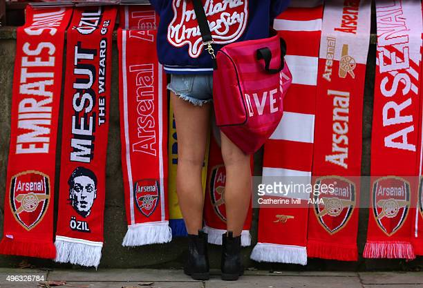 A fan in shorts stands in front of Arsenal scarves prior to the Barclays Premier League match between Arsenal and Tottenham Hotspur at Emirates...