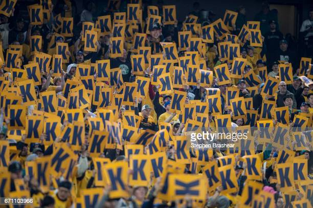 Fan in the 'King's Court' section cheer for a strike out by Felix Hernandez of the Seattle Mariners during a game against the Miami Marlins at Safeco...
