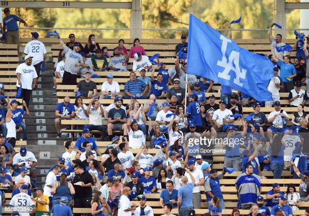 A fan in the left field pavilion runs through the crowd with an LA flag during game 2 of the NLDS between the Arizona Diamondbacks and the Los...