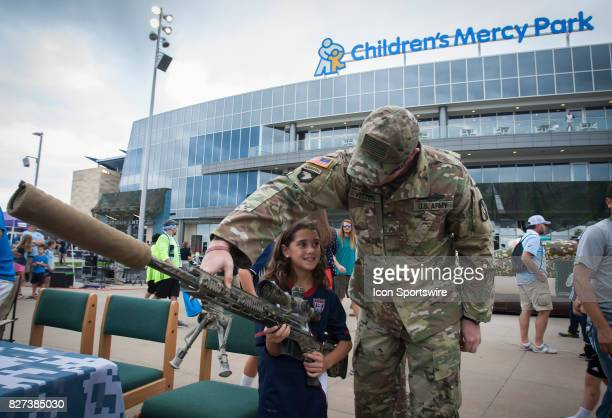 A fan interacts with military firearms during Military Appreciation day at Children's Mercy Park before the match between Sporting Kansas City and...