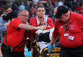 A fan is attended to by medical staff after she was hit by a broken bat during a game between the Boston Red Sox and the Oakland Athletics in the...