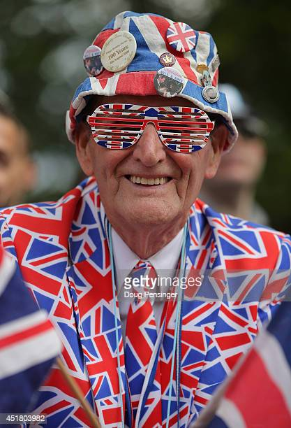 A fan is decked out in the Union Jack as he spectates at the finish of stage three of the 2014 Le Tour de France from Cambridge to London on July 7...