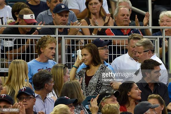 A fan is helped from her seat after being hit in the head by a foul ball from Anthony Gose of the Detroit Tigers during the sixth inning of the game...