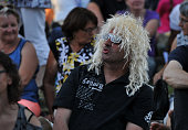 A fan is pictured before the concert of the french singer Michel Polnareff during the 23th edition of the Cognac Blues Passion festival in Cognac on...