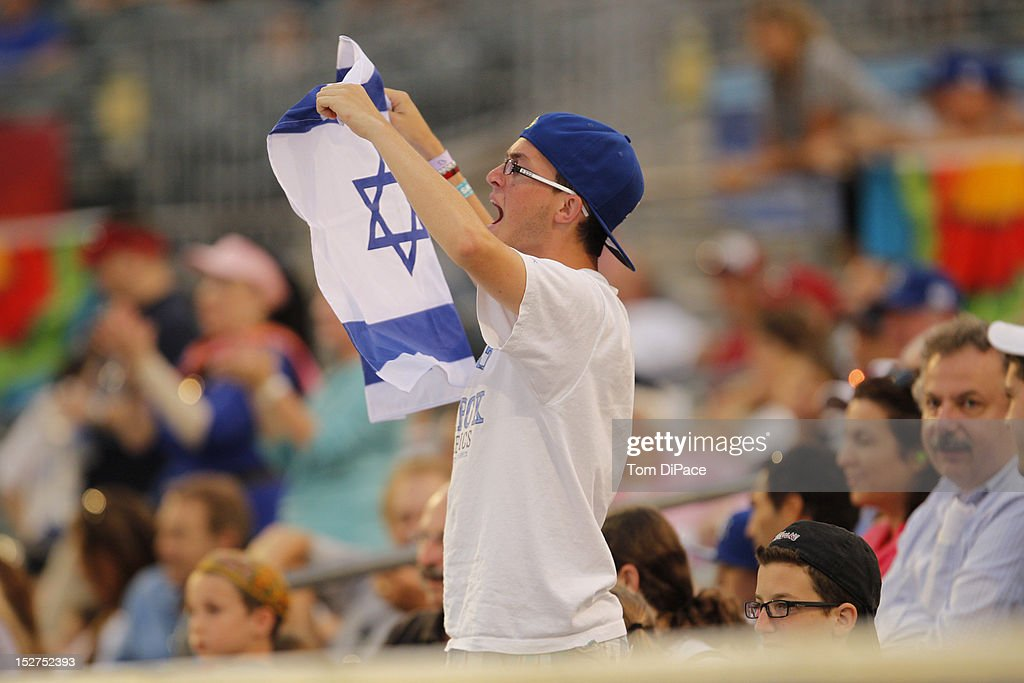 A fan is seen in the stands holding the flag of Israel during game 6 of the Qualifying Round of the World Baseball Classic at Roger Dean Stadium between Team Israel and Team Spain on September 23, 2012 in Jupiter, Florida.