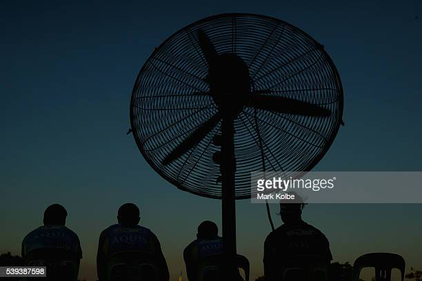 A fan is seen placed behind the Titans bench during the round 14 NRL match between the Parramatta Eels and the Gold Coast Titans at TIO Stadium on...