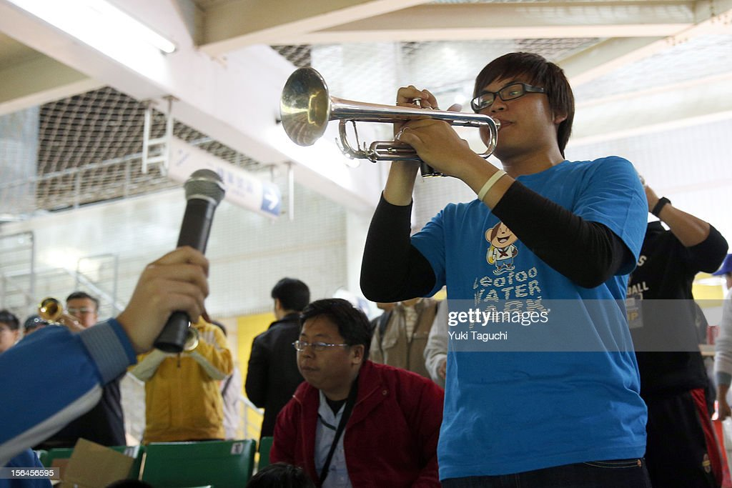A fan is seen playing a trumpet in the stands during Game 2 of the 2013 World Baseball Classic Qualifier between Team New Zealand and Team Chinese Taipei at Xinzhuang Stadium in New Taipei City, Taiwan on Thursday, November 15, 2012.