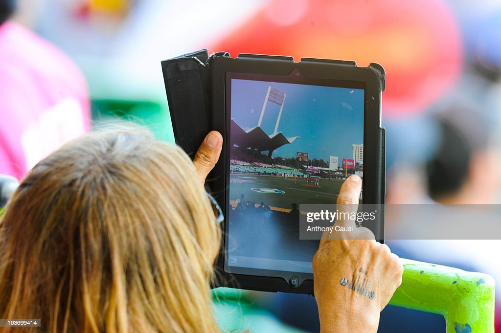 Fan is seen taking pictures with her iPad in the stands during Pool C, Game 5 between Spain and Venezuela in the first round of the 2013 World Baseball Classic at Hiram Bithorn Stadium on March 10, 2013 in San Juan, Puerto Rico.