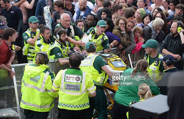 A fan is stretchered away by medical staff after collapsing during the The Pogues performance at British Summer Time Festival at Hyde Park on July 5...