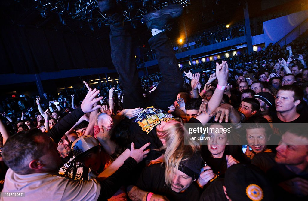 A fan is toppled head over head as Megadeth performs at the Myth Nightclub on November 23, 2013 in St. Paul, Minnesota. It was their first stop as part of their new Super Collider Tour.
