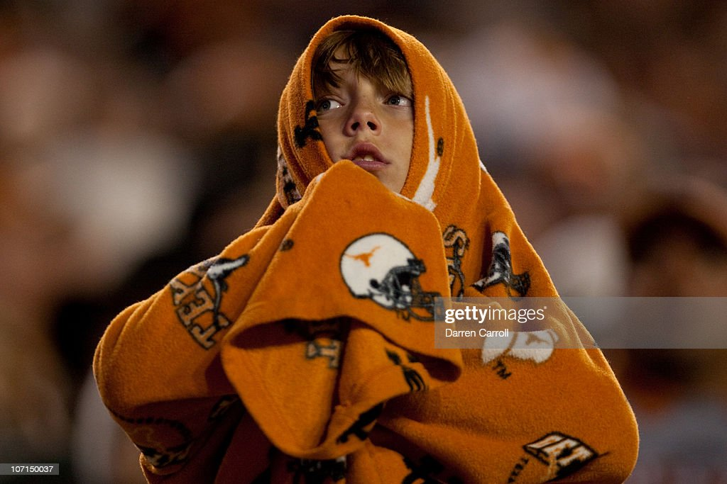 A fan keeps warm during the first half of the game between Texas A&M and the University of Texas at Darrell K. Royal-Texas Memorial Stadium on November 25, 2010 in Austin, Texas. Game-time temperature hovered near the 40-degree mark.