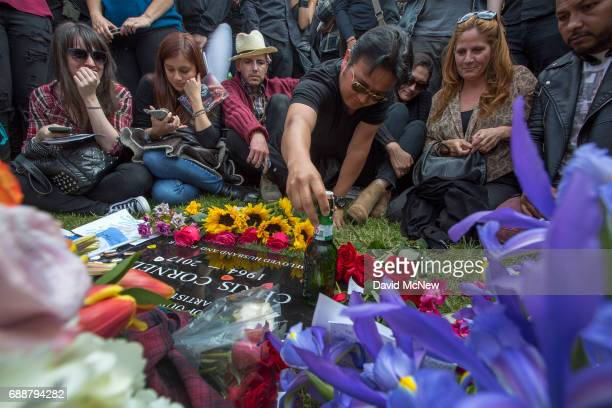 A fan leaves a graveside offering of beer after funeral services for Soundgarden frontman Chris Cornell at Hollywood Forever Cemetery on May 26 2017...