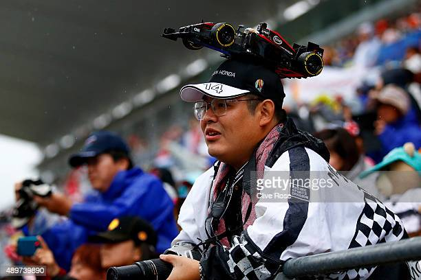 A fan looks on at a signing session during previews to the Formula One Grand Prix of Japan at Suzuka Circuit on September 24 2015 in Suzuka