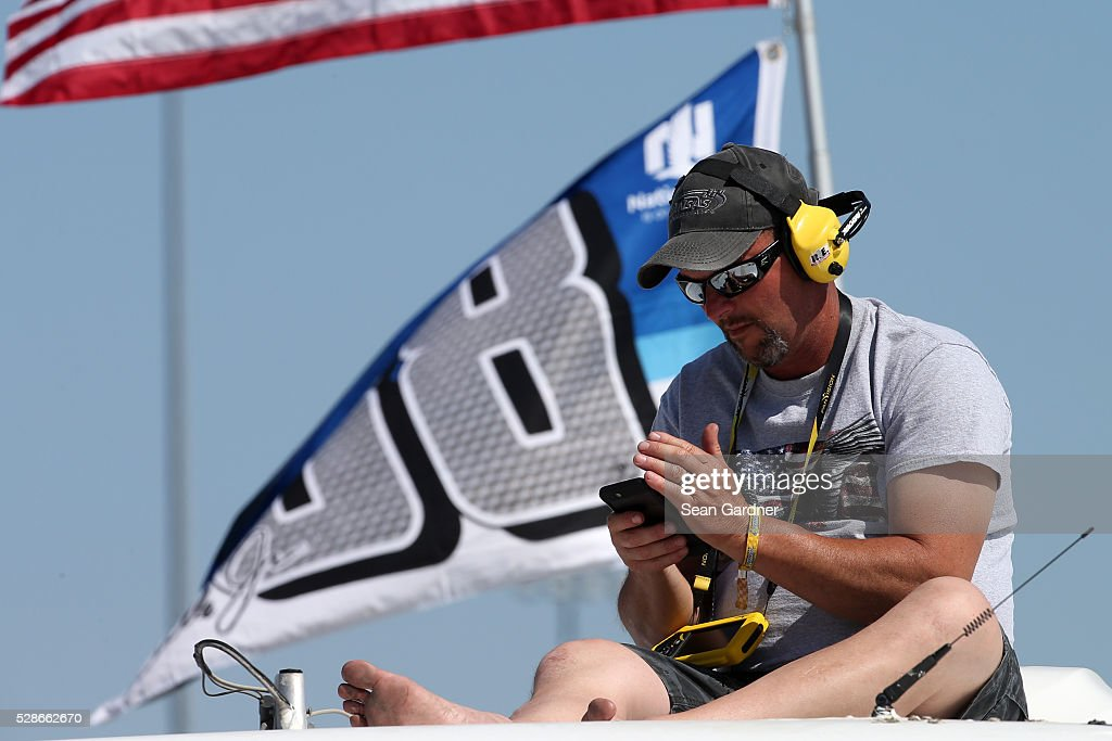 A fan looks on during qualifying for the NASCAR Camping World Truck Series Toyota Tundra 250 at Kansas Speedway on May 6, 2016 in Kansas City, Kansas.