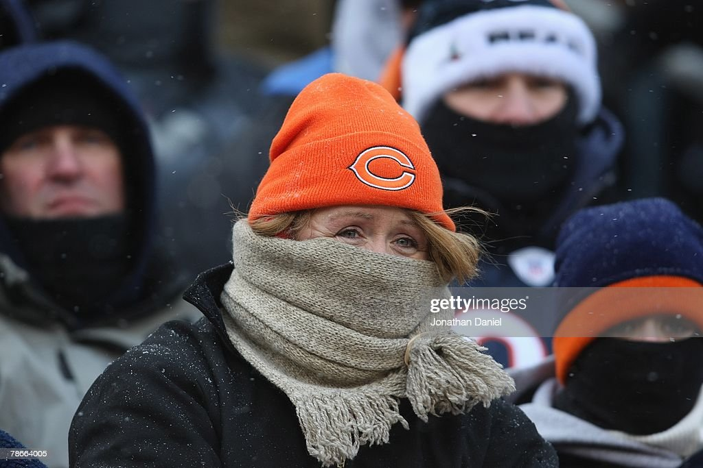 A fan looks on during the game between the Green Bay Packers and the Chicago Bears on December 23, 2007 at Soldier Field in Chicago, Illinois. The Bears defeated the Packers 35-7.
