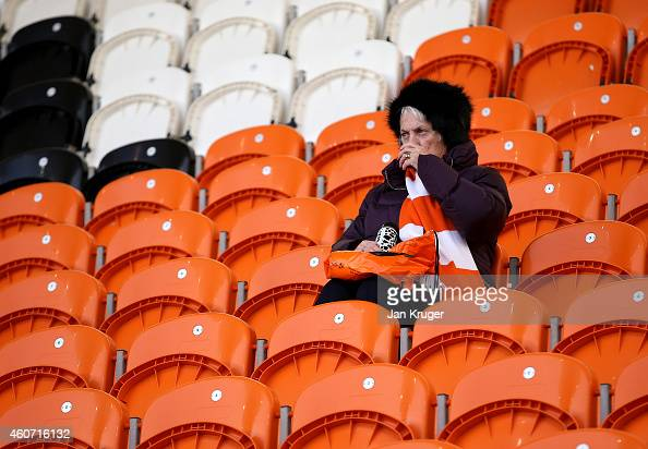 A fan looks on during the Sky Bet Championship match between Blackpool and Bournemouth at Bloomfield Road on December 20 2014 in Blackpool England