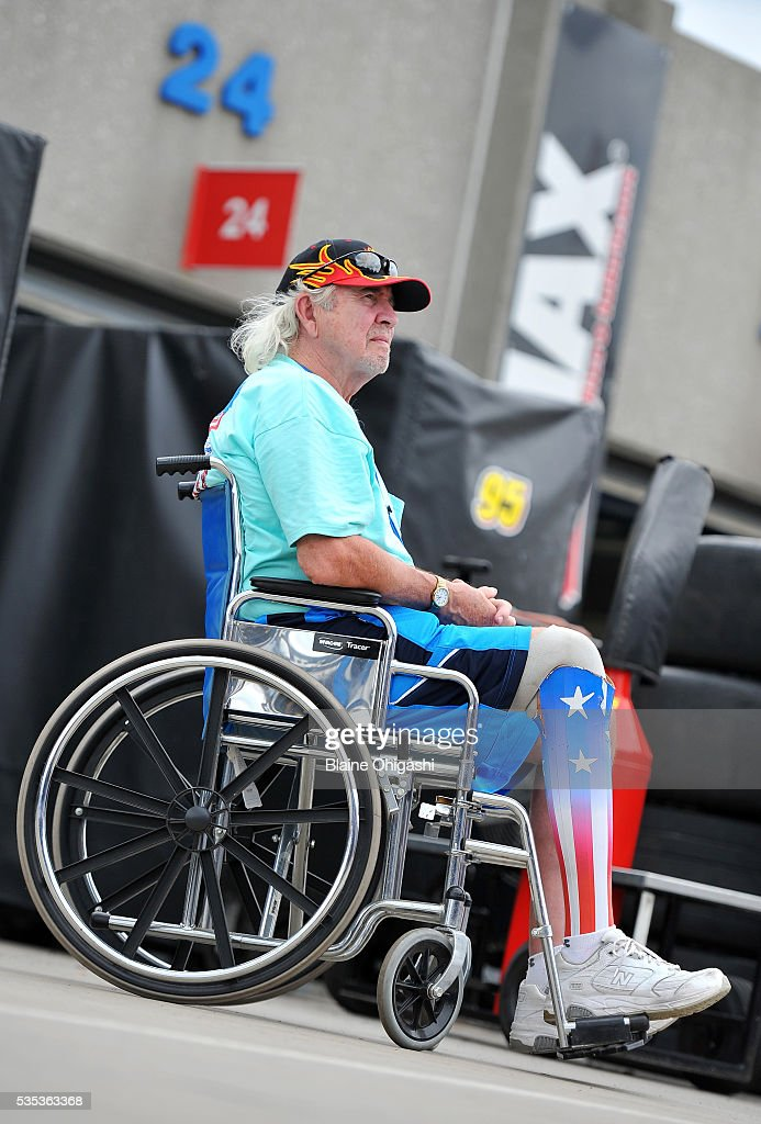 A fan looks on in the garage area prior to the start of the NASCAR Sprint Cup Series Coca-Cola 600 at Charlotte Motor Speedway on May 29, 2016 in Charlotte, North Carolina.