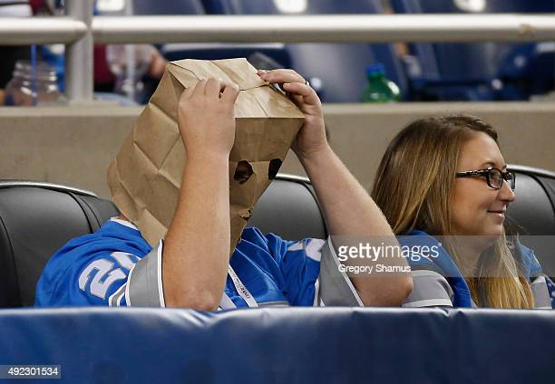 A fan looks on with a bag on his head during a game between the Detroit Lions and the Arizona Cardinals at Ford Field on October 11 2015 in Detroit...