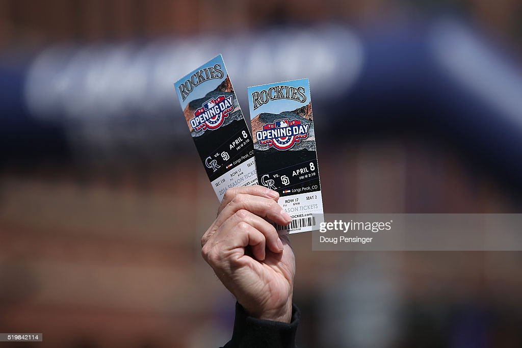 A fan looks to sell tickets outside the stadium as the San Diego Padres face the Colorado Rockies during opening day at Coors Field on April 8, 2016 in Denver, Colorado.