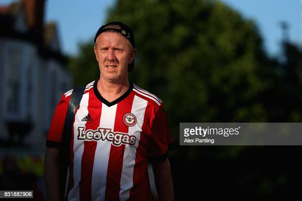 A fan makes his way to the stadium priorto the Sky Bet Championship match between Brentford and Bristol City at Griffin Park on August 15 2017 in...