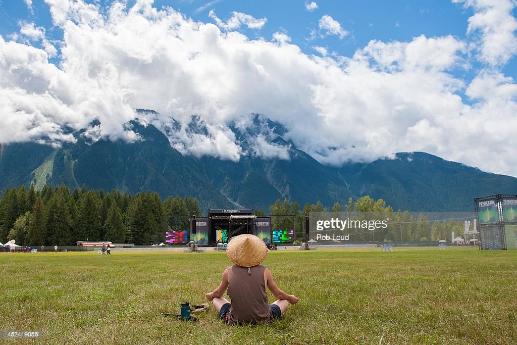 A fan meditates at the Pemberton Music Festival is seen on July 19, 2014 in Pemberton, Canada.