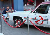 Fan observes the 'Ghostbusters' Cadillac Fleetwood Station Wagon at AMC Universal City Walk on July 14 2016 in Universal City California