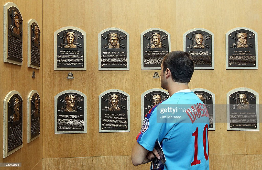 A fan of 2010 inductee Andre Dawson views the plaques of inducted members at the Baseball Hall of Fame and Museum during induction weekend on July 24, 2010 in Cooperstown, New York.