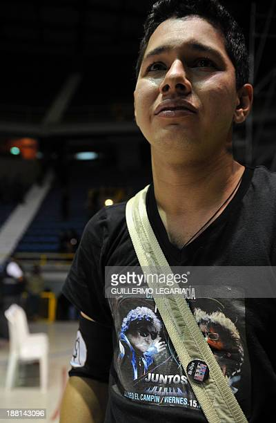 A fan of Argentine musician Charly Garcia cries following the announcement that Garcia had had taken ill on his way to the concert and been rushed to...
