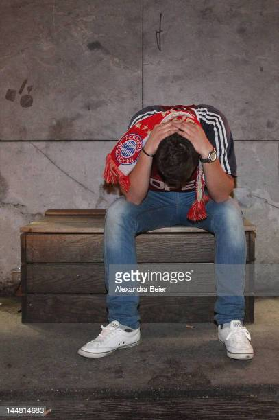 A fan of Bayern Muenchen reacts after his team's loss of the UEFA Champions League final between FC Bayern Muenchen and Chelsea FC in the inner city...