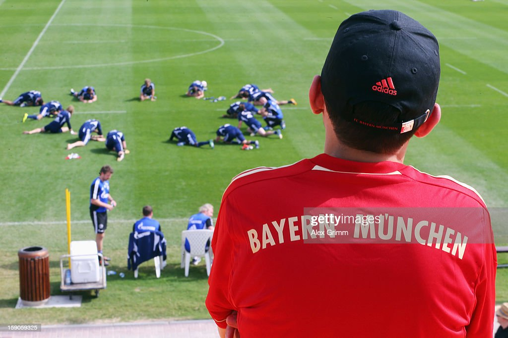 A fan of Bayern Muenchen watches a Schalke 04 training session at the ASPIRE Academy for Sports Excellence on January 7, 2013 in Doha, Qatar.