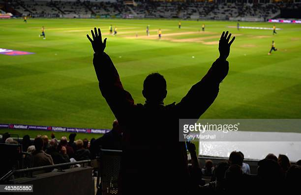 A fan of Birmingham Bears celebrates his team taking a wicket during the NatWest T20 Quarter Final match between Birmingham Bears and Essex Eagles at...